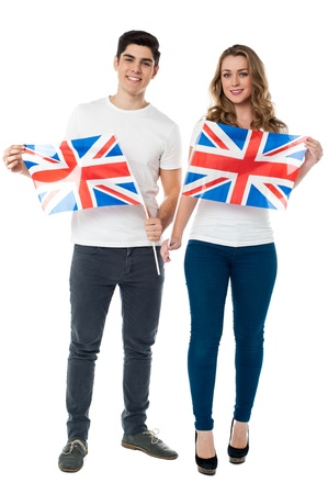Young couple holding UK flag with pride photo