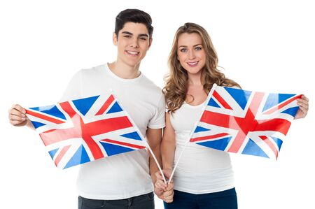 Proud young couple holding British flag photo