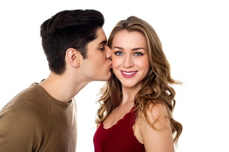 fashionable couple: Young lover boy kissing his girlfriend