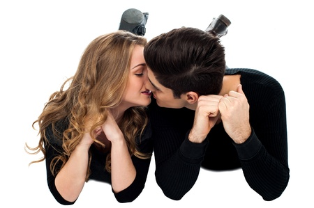 Romantic couple lying on the floor and kissing photo