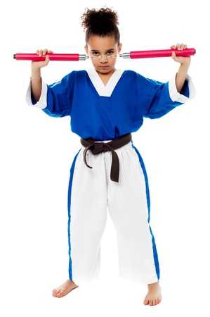 fu: Karate girl getting ready to fight with nunchucks