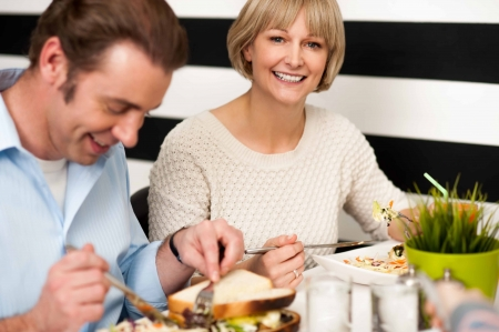 Weekend outing, couple enjoying breakfast in restaurant. photo