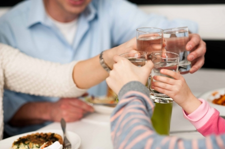 man drinking water: Its time to celebrate. Family toasting. Stock Photo