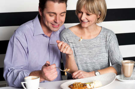 Couple enjoying vegetarian and healthy breakfast. photo