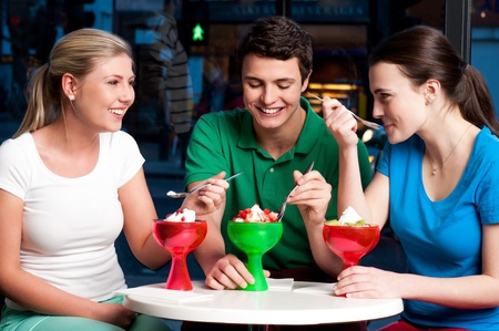 relishing: Three friends enjoying day out in a restaurant