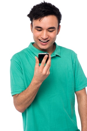 cool boy: Joyous young guy with his new cellphone