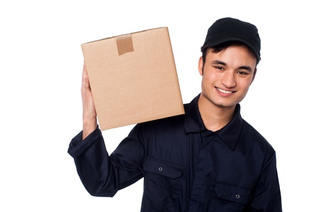 Young delivery boy with carton box on shoulders photo