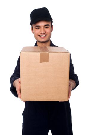 Smiling young guy in uniform holding parcel photo