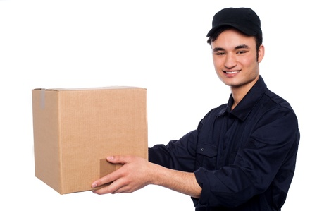 Young guy in uniform delivering parcel photo