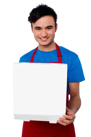 Isolated male chef holding pizza box photo