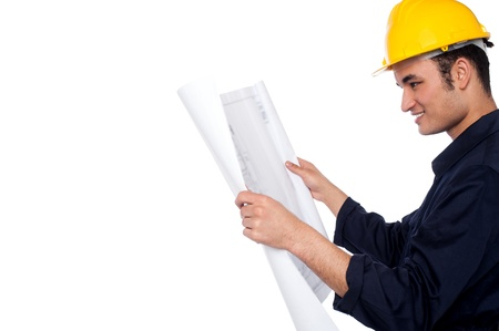 Male contractor reviewing construction plan photo