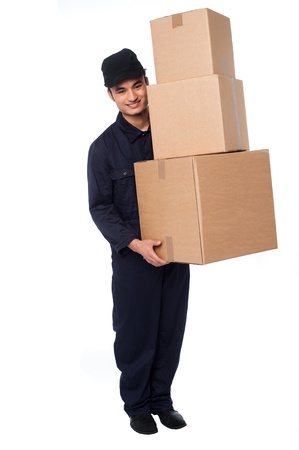 Delivery guy holding stack of parcel boxes Stock Photo - 21356899