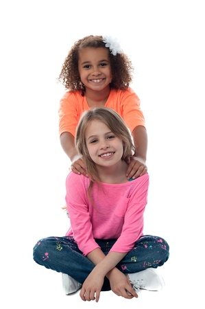 Smiling pretty little girls posing together photo