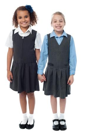 Cheerful school girls posing together photo