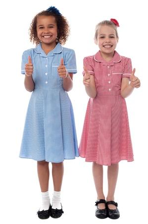 yup: Pretty school girls gesturing thumbs up
