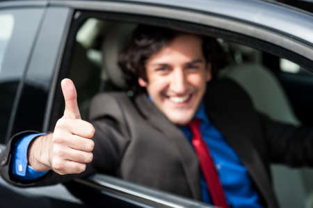 Man showing thumbs sign after completing test drive Stock Photo - 21332684