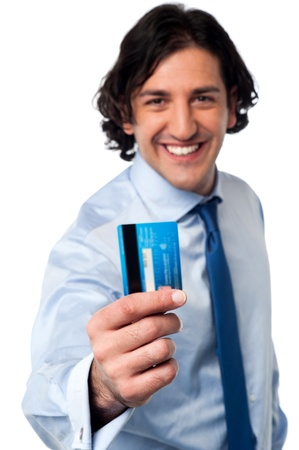 Smiling corporate man displaying his credit card photo