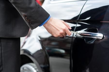 locked the door locked: Man unlocking the door of his car, cropped image Stock Photo