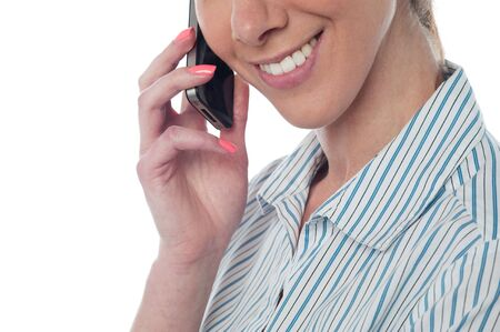 Business lady using cellphone, cropped image. photo