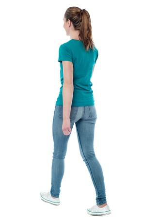 woman posture: Casual woman walking away from the camera