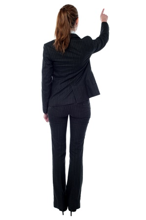 Female employee facing towards the wall photo