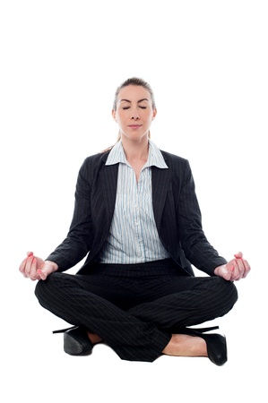 formals: Businesswoman meditating in lotus posture Stock Photo