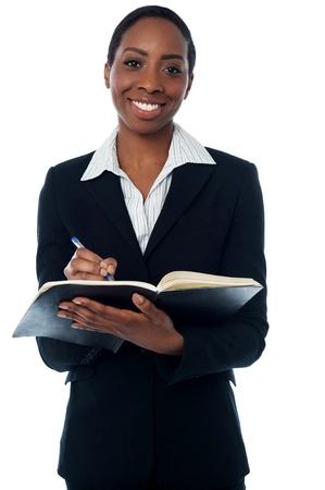 secretary woman: Secretary making a list of appointments Stock Photo