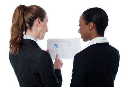 Female executives analyzing documents photo