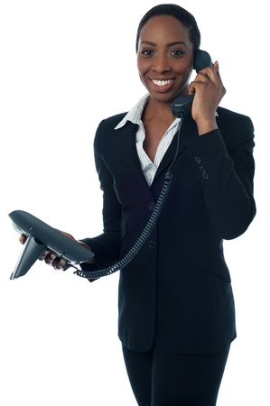 Businesslady speaking to client over the phone photo