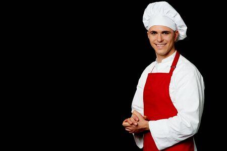 half  length: Half length portrait of a chef posing in uniform