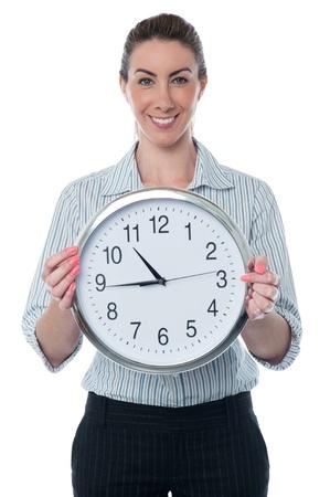 wall clock: Corporate woman displaying wall clock
