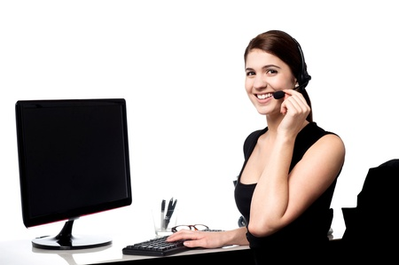 Pretty female support staff attending clients queries  photo