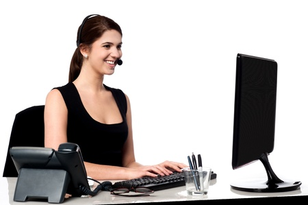 Executive working on computer while attending call photo