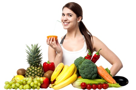 Woman with fruits and vegetables and fresh orange juice photo