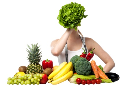 Attractive young woman hiding her face with spinach photo