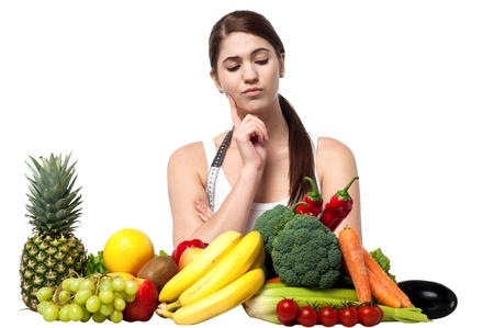 Nutritionist thinking to select the best for her diet chart photo