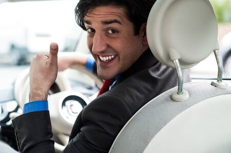 Man showing thumbs sign after completing test drive  Stock Photo - 21362906