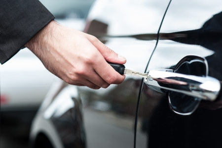 locked: Man unlocking the door of his car, cropped image Stock Photo