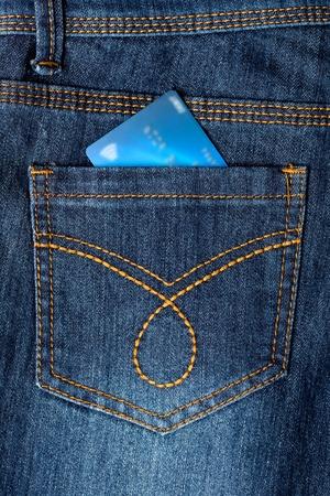 debit card: Debit card placed in back pocket of a jeans