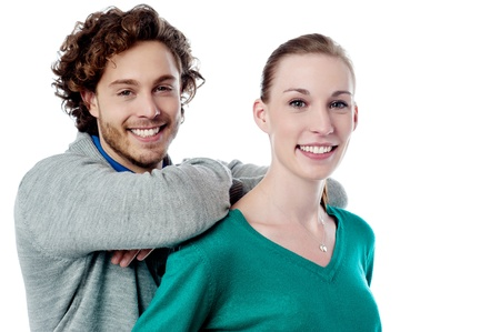 Young guy leaning on his girlfriends shoulders photo