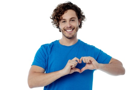 Handsome guy making heart shape with his hands