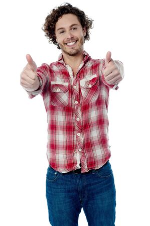 thumbs up symbol: Young man showing double thumbs up