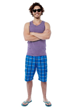 flip flops: Happy man with sunglasses in a beach holiday wear Stock Photo