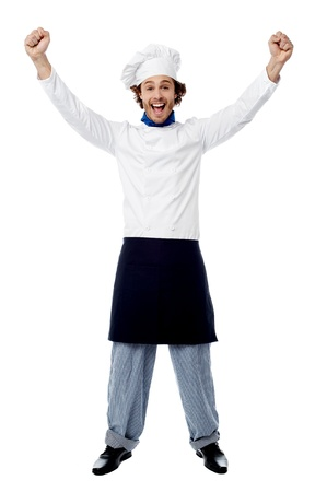 caterer: Excited young male chef over white background Stock Photo