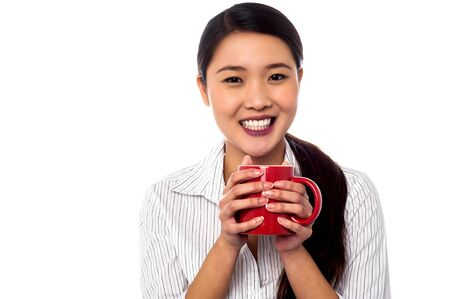 Young relaxed businesswoman enjoying coffee photo