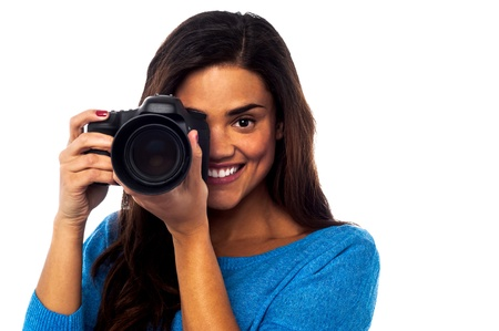 cropped shots: Female photographer focusing to capture your snap