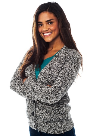 Smiling young pretty african american woman standing with hands folded photo