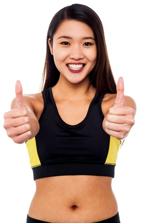 yup: Fit chinese girl showing double thumbs up