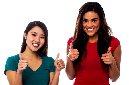 Two cool friends showing double thumbs up Stock Photo - 21423707