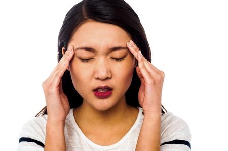 unfit: Girl applying gentle pressure on temples of her head